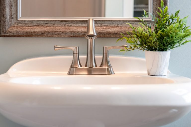 Bathroom sink with brushed nickel faucet