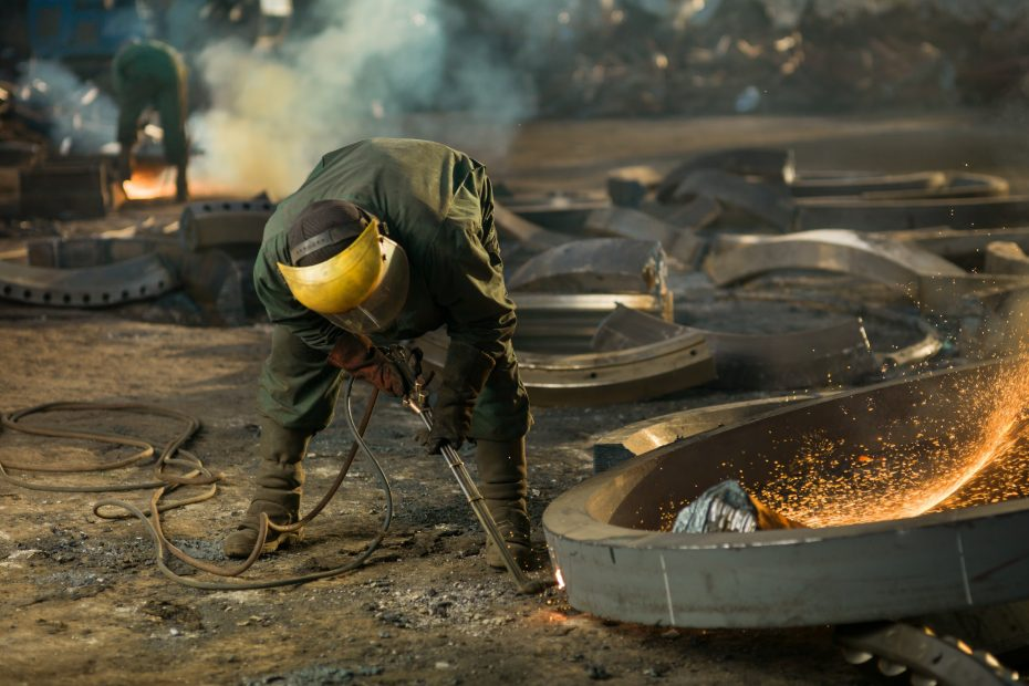 welder on recycling site